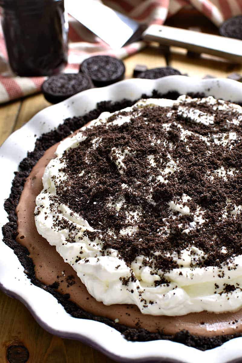 This Frozen Death by Chocolate Pie is the ULTIMATE chocolate lover's treat! Loaded with delicious chocolate flavor and topped with homemade whipped cream and hot fudge, this pie is perfect for birthdays, ladies nights, or special occasions. And best of all, it's completely no-bake!