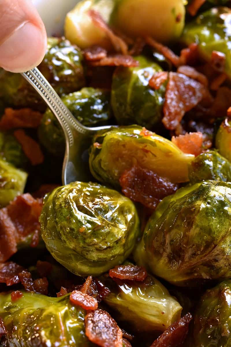 These Maple Bacon Roasted Brussels Sprouts are the ultimate side dish! Fresh brussels sprouts roasted in olive oil, butter, and maple syrup, then tossed with crispy bacon and sprinkled with sea salt. Perfect for dinner anytime and great for the holidays, too!