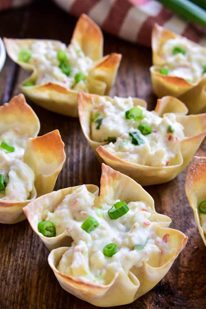 If you love crab rangoon, you'll LOVE these baked Crab Rangoon Wonton Cups! They have all the flavors of your favorite Chinese appetizer in a baked wonton cup, which means they're not only better for you, but they're so much easier to make. Ready in 30 minutes or less, these bite sized wontons are the perfect appetizer for all your holiday parties....and guaranteed to be a HUGE hit. Serve them straight out of the oven or dip them in your favorite sweet & sour sauce. Any way you enjoy them, there's no question that this recipe is sure to become a favorite!