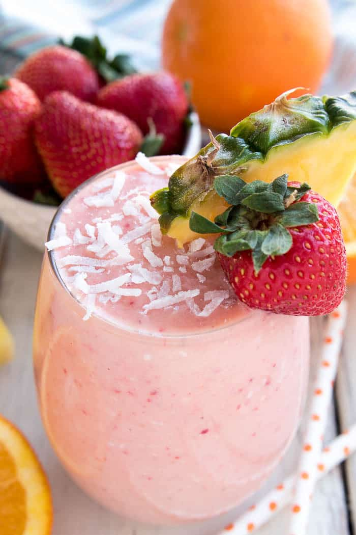 Start the New Year off right with this delicious Tropical Smoothie! Loaded with all the tropical flavors you love, this smoothie is the perfect way to beat the winter blues....and since it's made with frozen fruit, it's easy to make and enjoy all year round! Whether you like them for breakfast, snack time, or even dessert, you'll LOVE the refreshing taste of this Tropical Smoothie. And best of all, it couldn't be easier to make!