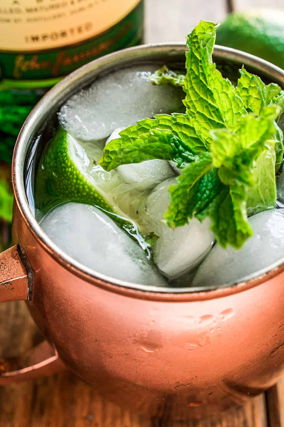 Close up of Irish Mule in mug with fresh mint and lime