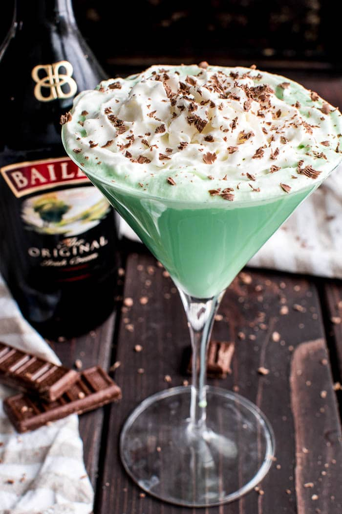 This Baileys Mint Martini is the ultimate combo! Creme de Menthe combined with Baileys Irish Cream in one delicious cocktail that's perfect for St. Patrick's Day, Christmas, or any special occasion. This minty martini not only tastes amazing, but also has the most vibrant green color, making it a fun and festive cocktail for all your holiday celebrations! If you love Baileys, you can't go wrong with this delicious Baileys Mint Martini....made with just 4 ingredients!