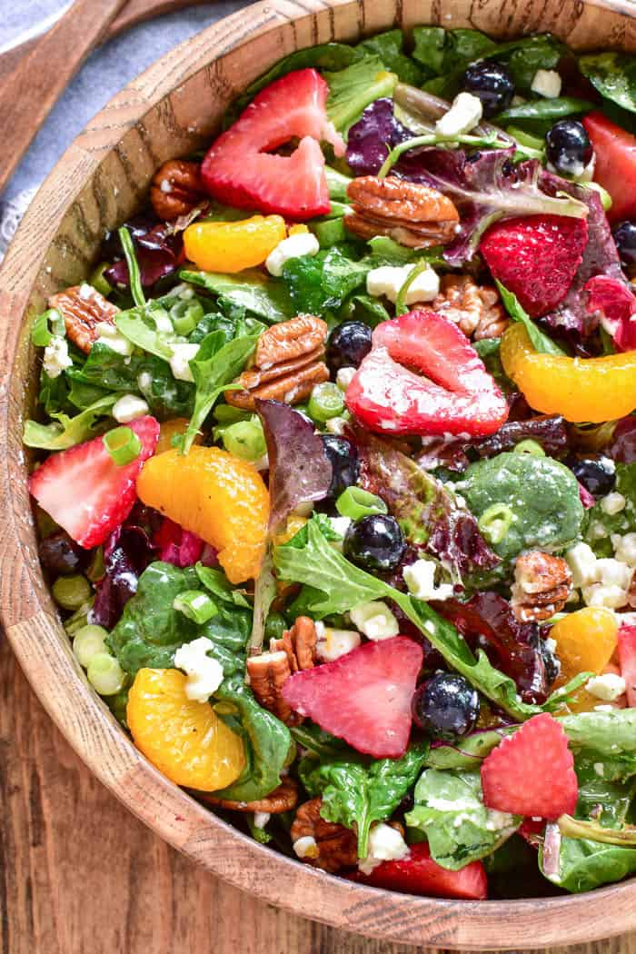 Take advantage of fresh berry season with this delicious Summer Strawberry Salad. Loaded with fresh strawberries, blueberries, mandarin oranges, pecans, goat cheese, and sparkling orange vinaigrette, this salad is the perfect balance of savory, sweet, crunchy, creamy, and YUMMY!