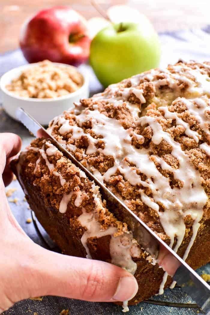 Knife cutting apple bread