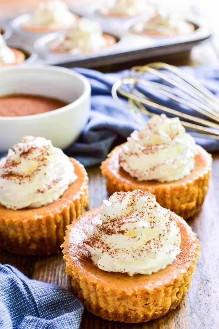 Mini Pumpkin Cheesecakes on wooden table
