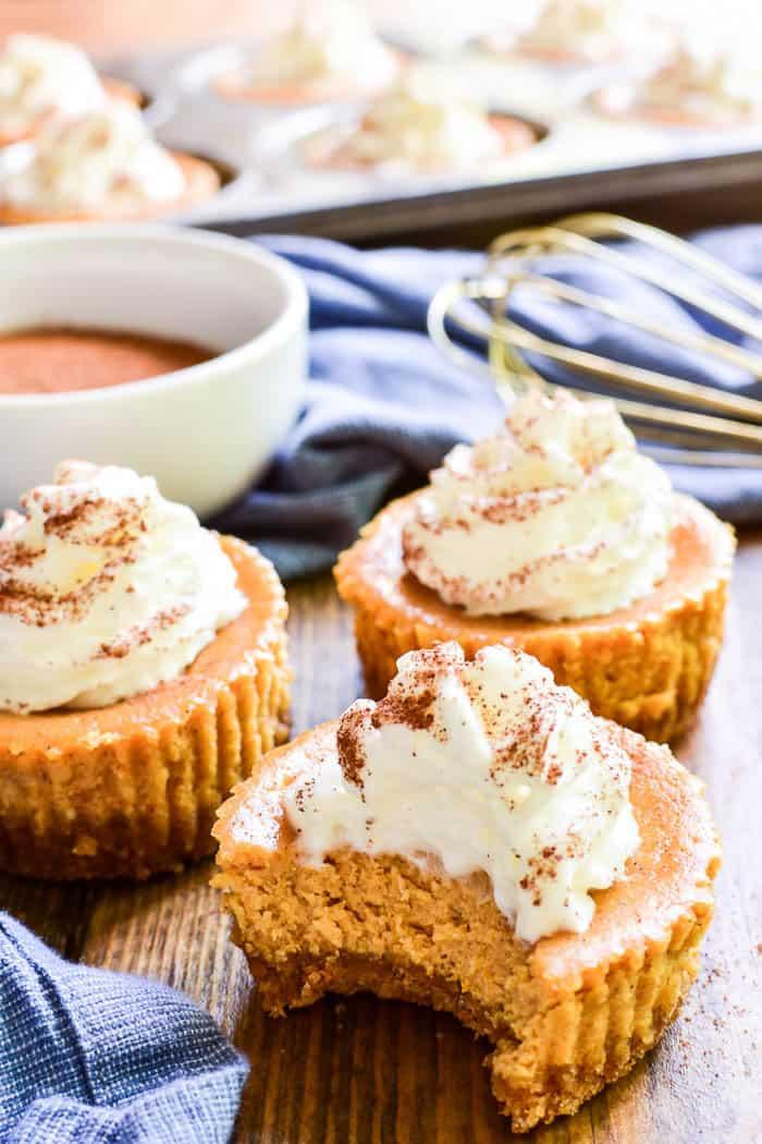 Mini Pumpkin Cheesecakes with bite taken