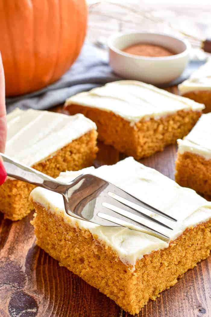Pumpkin Sheet Cake is the ultimate taste of fall! Light, fluffy pumpkin cake topped with cream cheese frosting and a twist of maple syrup. This cake is easy to make and ideal for feeding a crowd. The perfect dessert for Thanksgiving or any fall gathering!