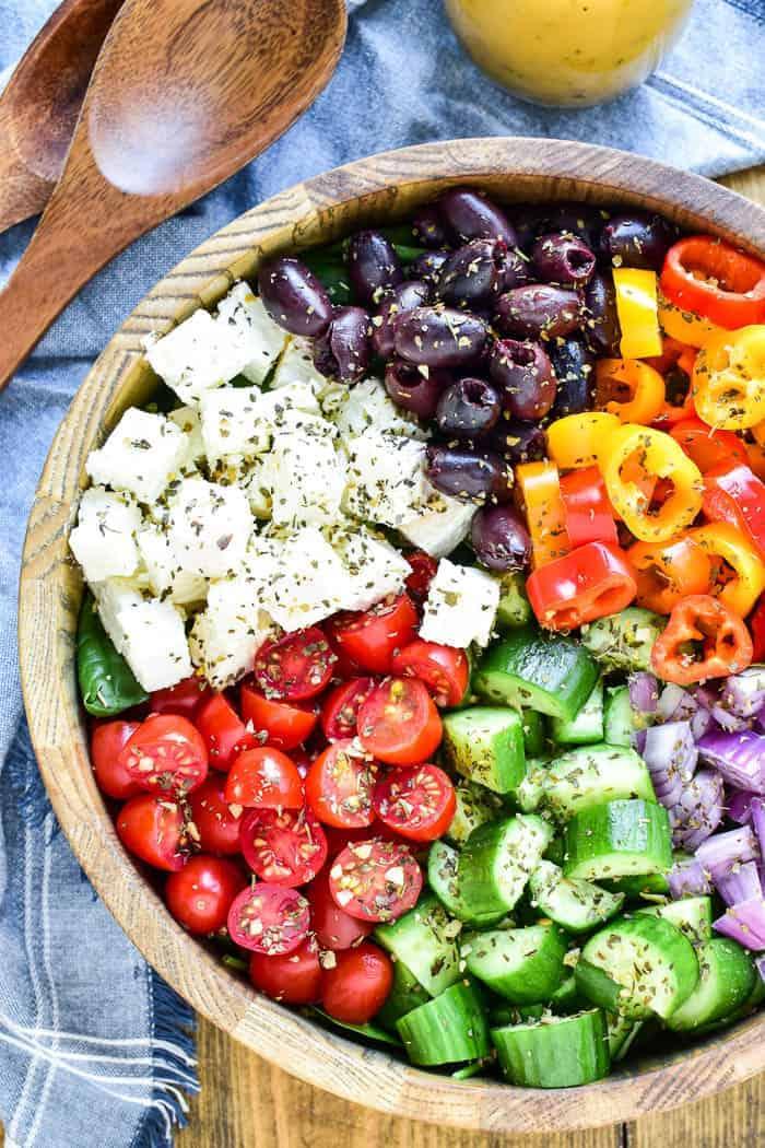 Greek Salad in serving bowl with wooden salad servers