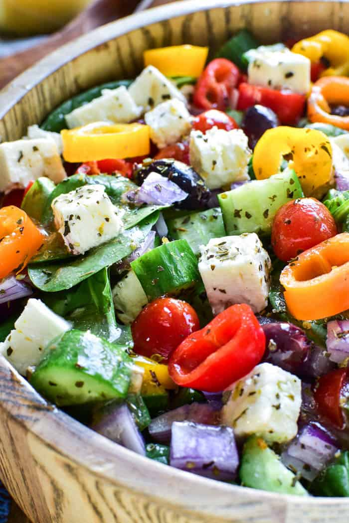 Greek Salad in salad bowl with dressing