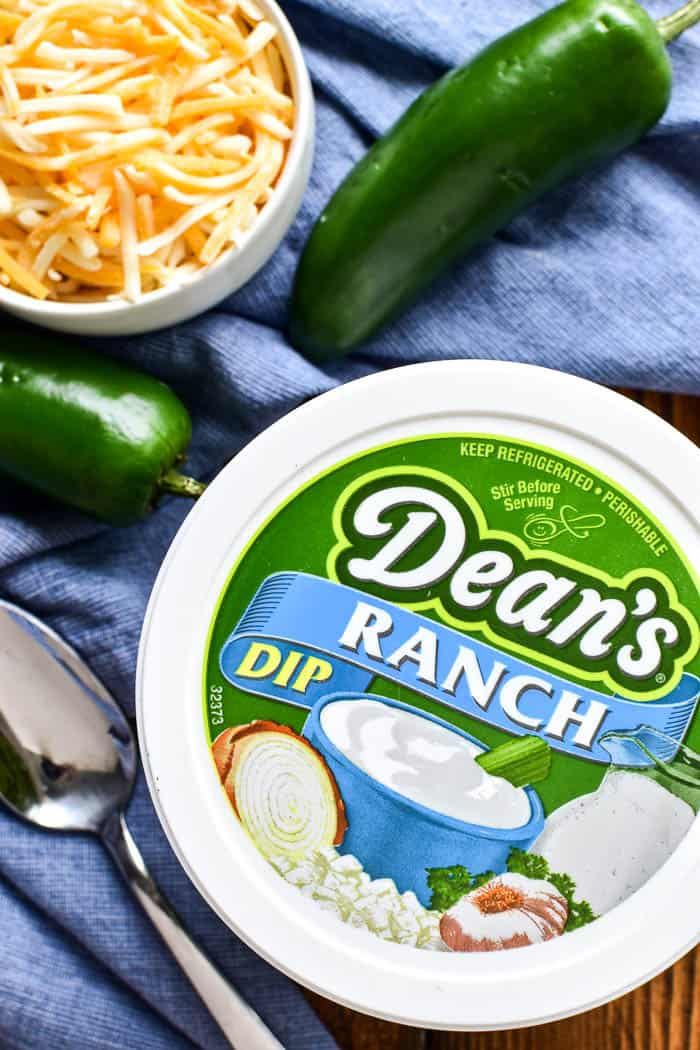 Container of Dean's Ranch Dip with jalapeños and cheese