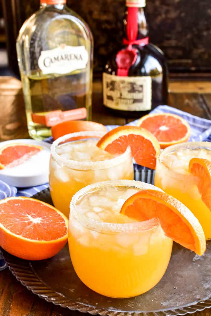 Orange Margaritas on serving tray with Camarena Tequila and Grand Marnier in background
