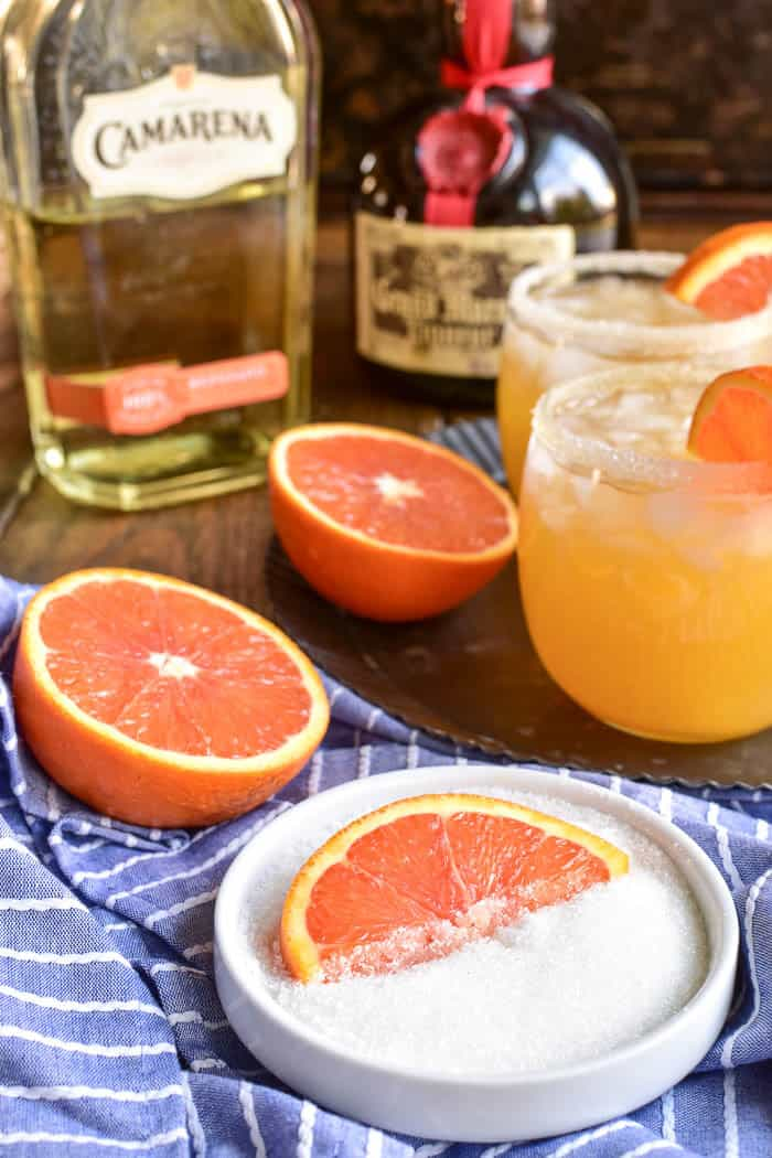 Dish of sugar with orange slice, Camarena Tequila, and Grand Marnier