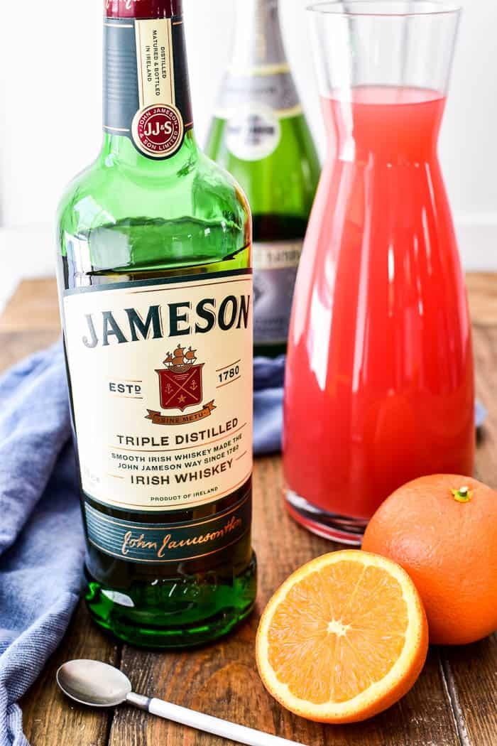 Jameson Irish Whiskey, grapefruit juice, and oranges