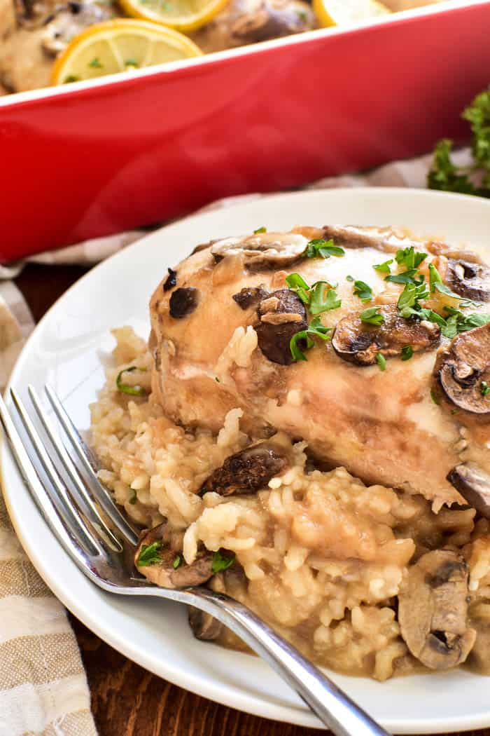 Lemon Chicken Rice Casserole on plate with fork