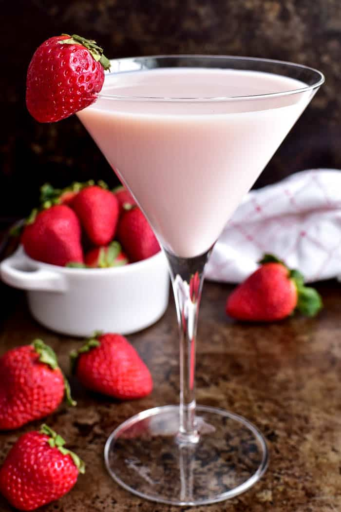 Strawberry Shortcake Martini in martini glass with strawberries