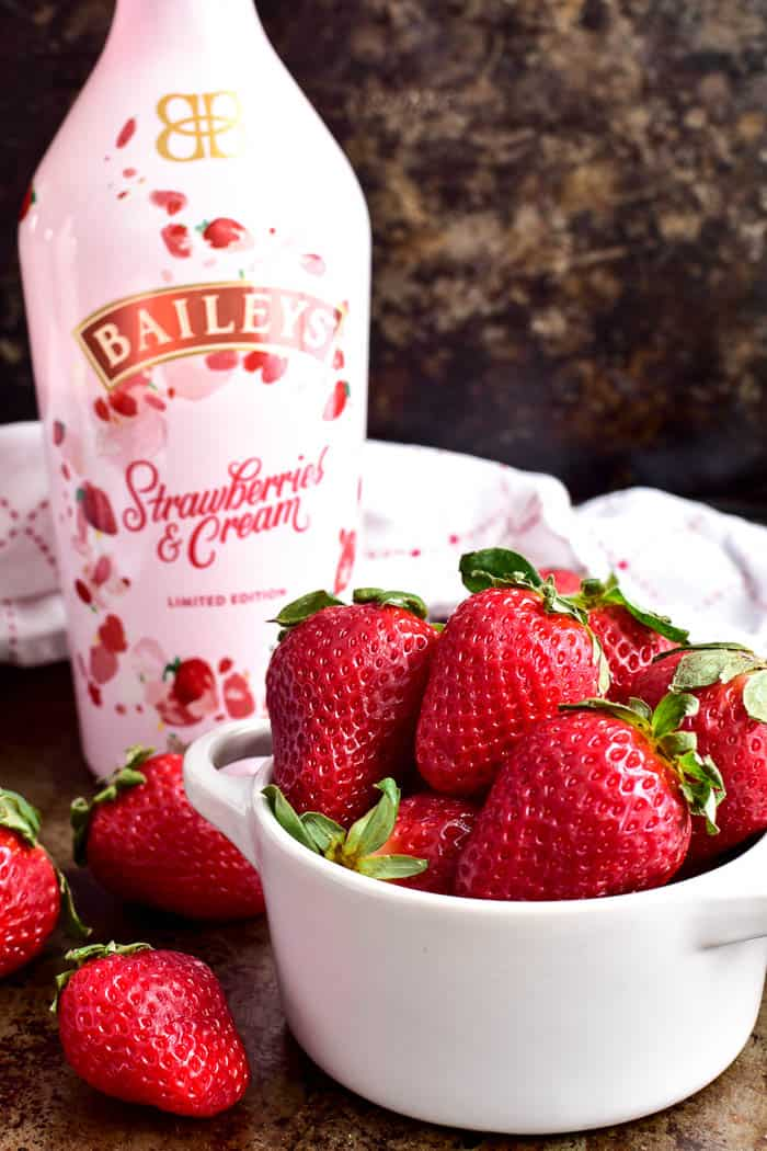 Fresh strawberries with Baileys Strawberries & Cream bottle