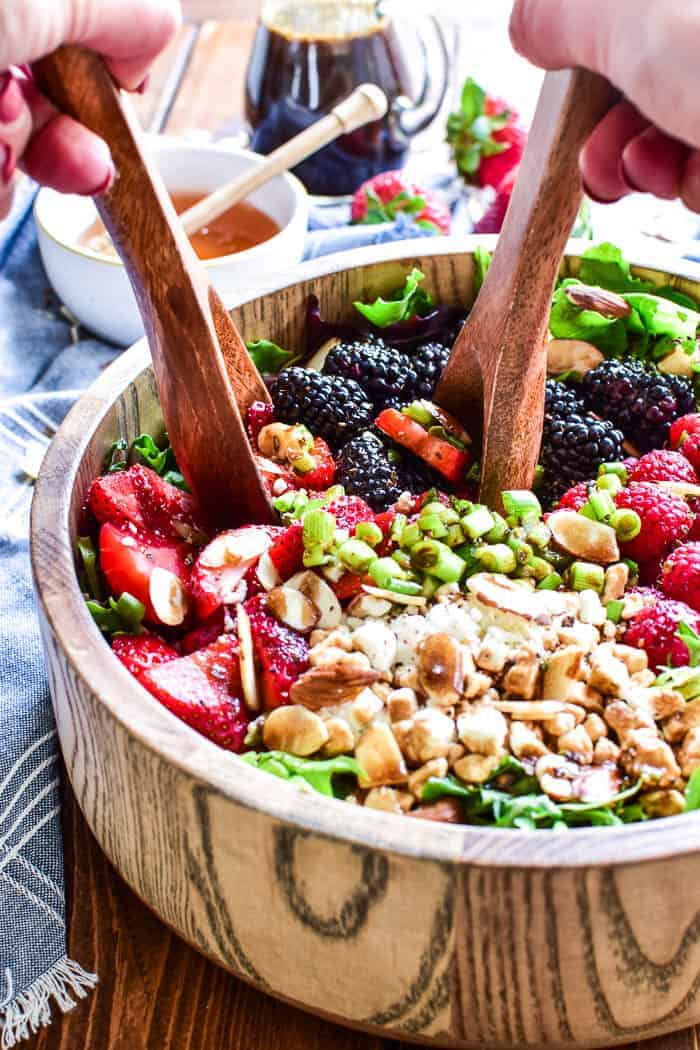 Triple Berry Salad with wooden salad servers