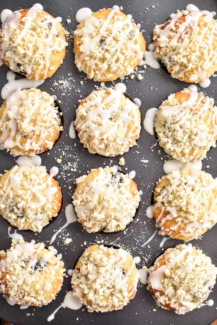 Overhead of a dozen Blackberry Streusel Muffins in pan