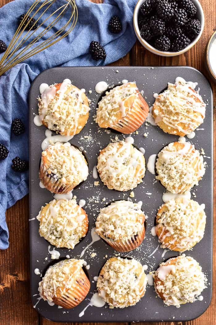 A dozen Blackberry Streusel Muffins in muffin pan