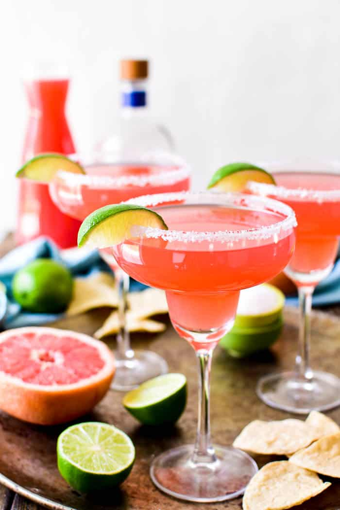Grapefruit Margaritas with ingredients in the background