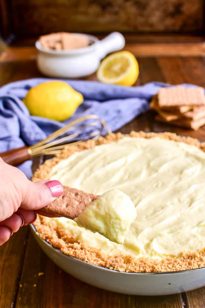 Lemon Pie Cheesecake Dip on a graham cracker