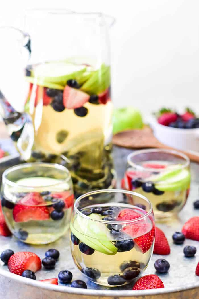 White Sangria in glasses with pitcher in the background
