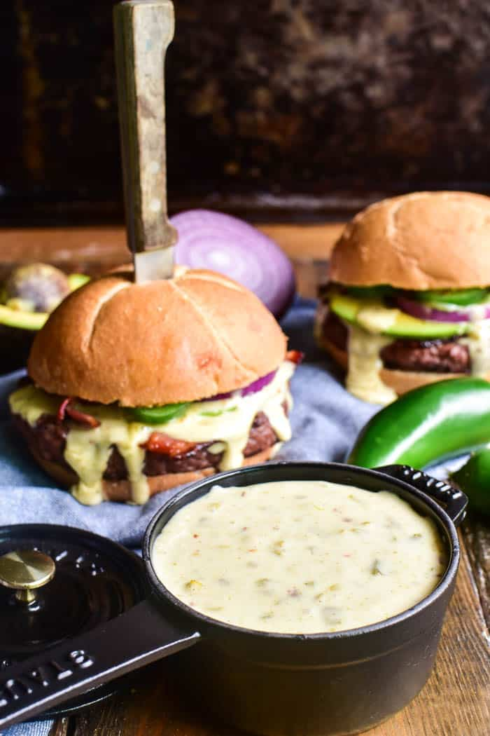 Queso in a dish with Queso Burgers