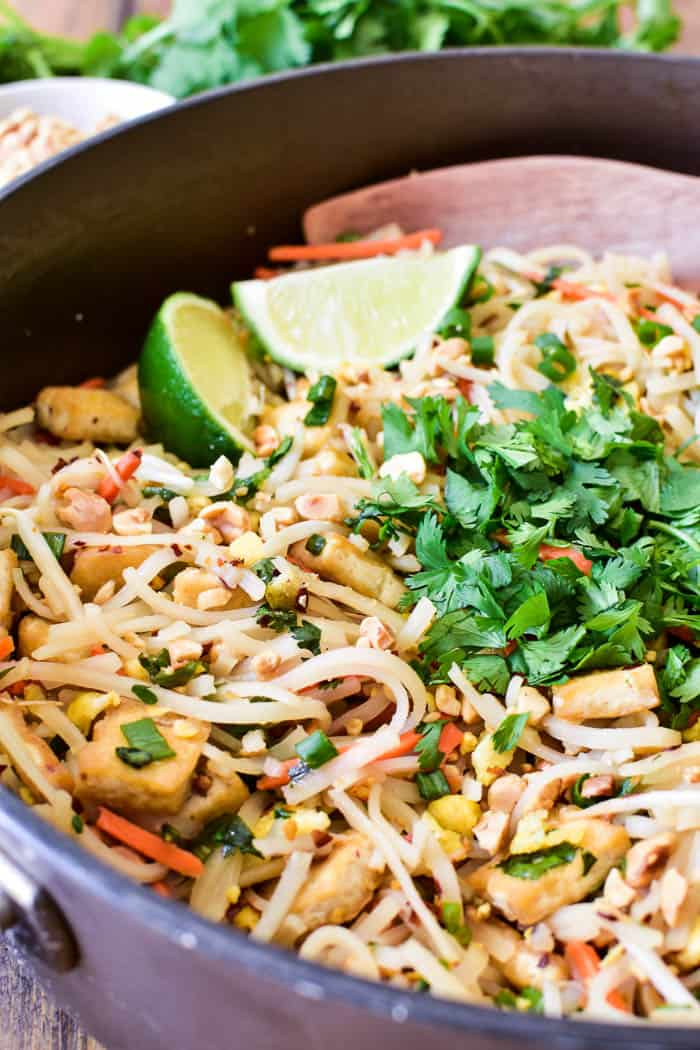Close up of Pad Thai in pan with serving spoon
