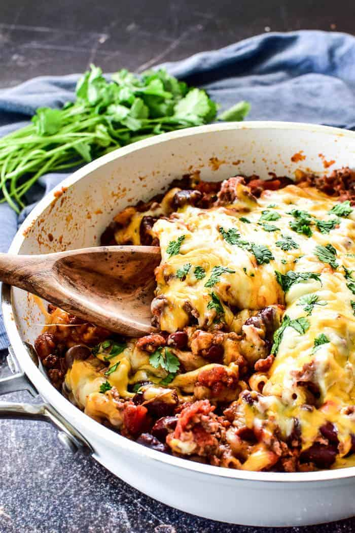 Cheesy Chili Mac in skillet with serving spoon