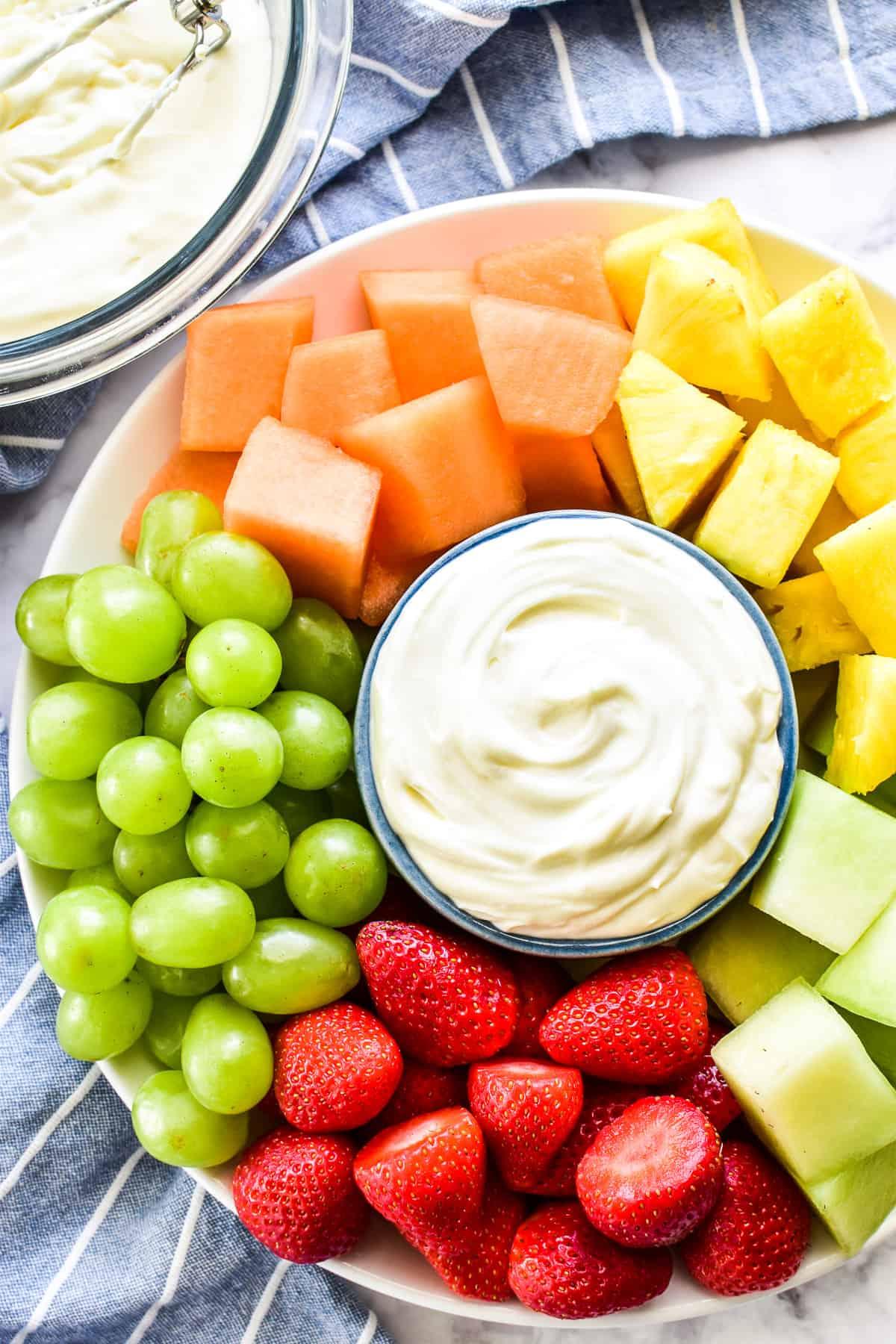 Overhead shot of fruit dip with fresh fruit on platter