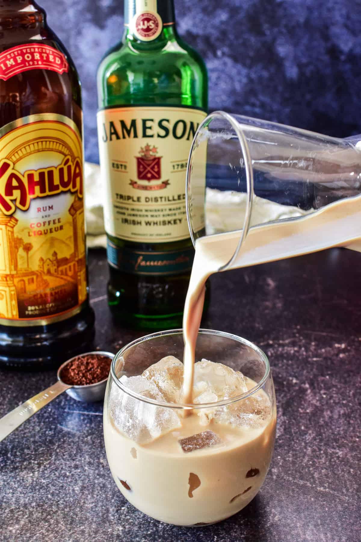 Pouring Irish Cream over ice