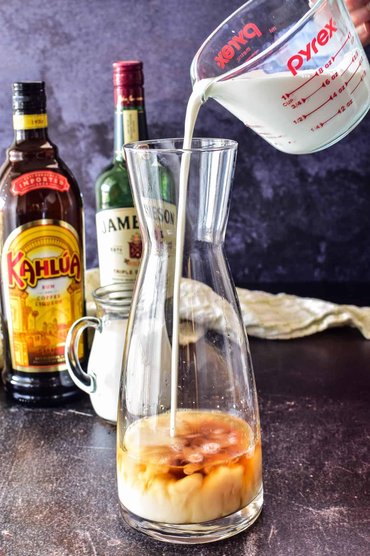 Adding half & half to carafe with whiskey for Irish Cream recipe