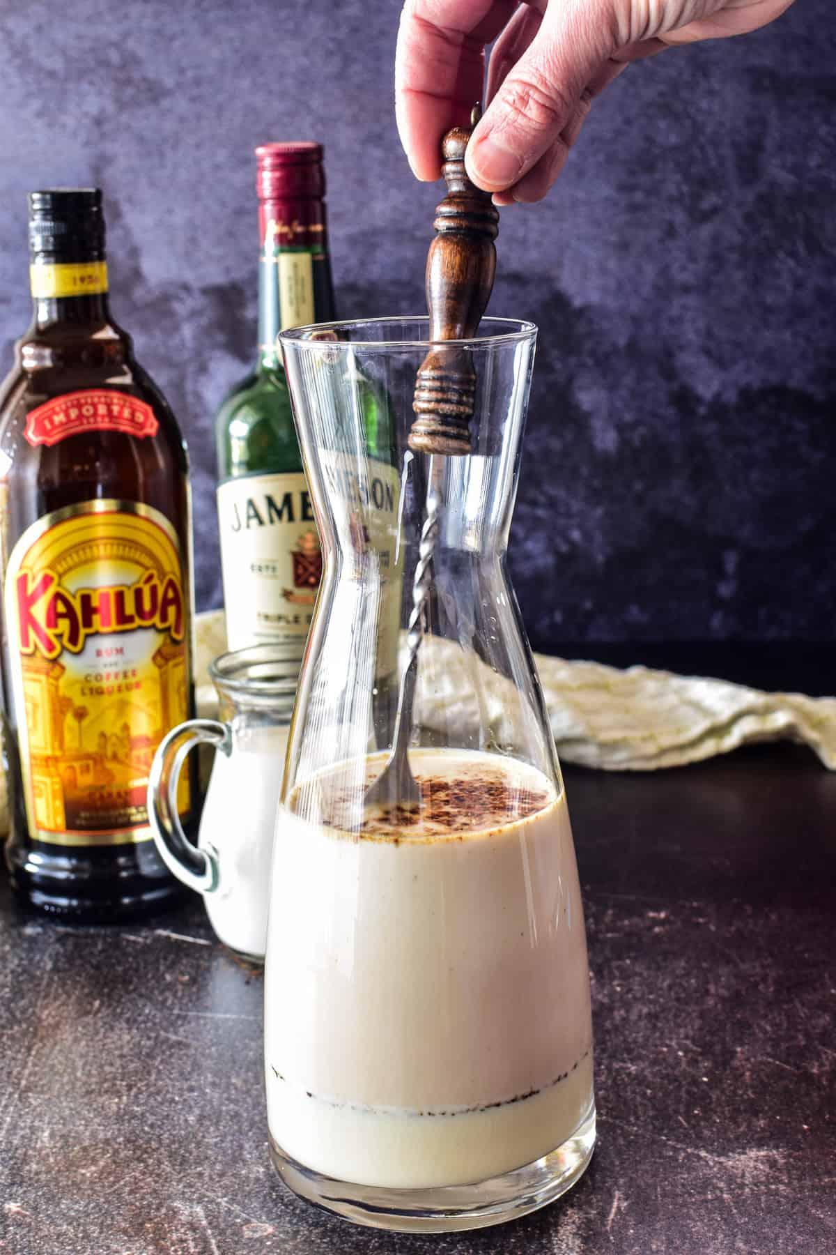 Stirring Irish Cream ingredient in carafe