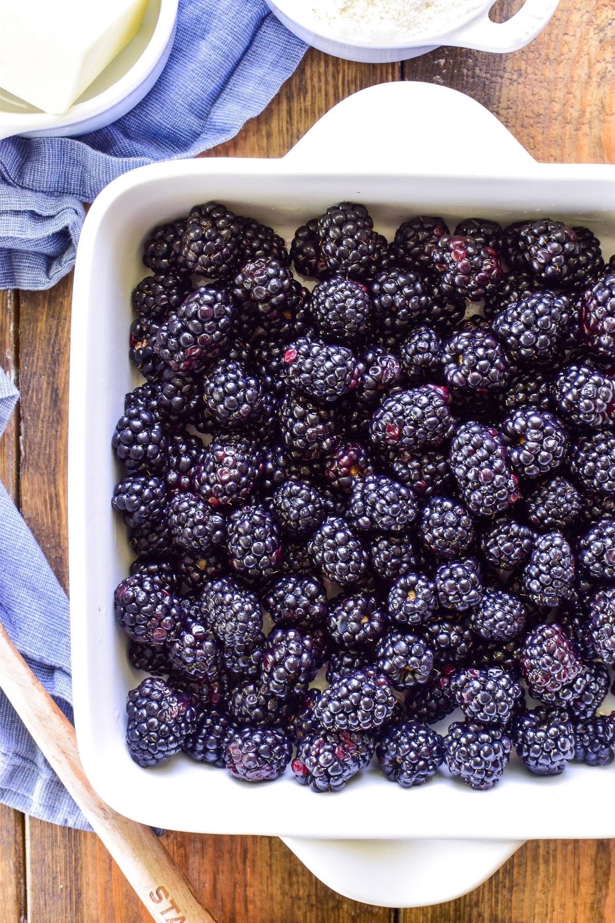 Fresh blackberries in white baking pan
