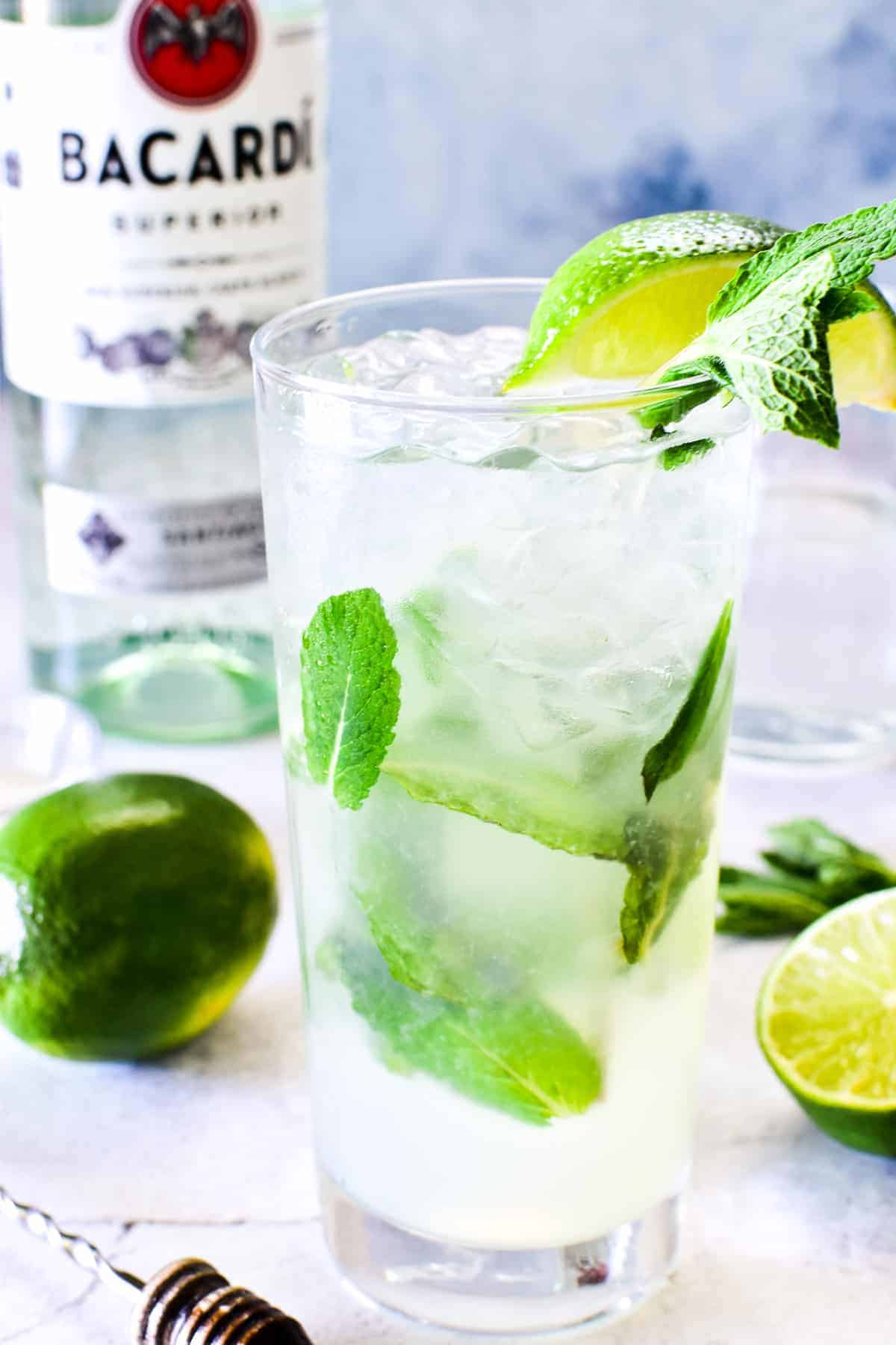 Mojito in glass with lime wedge and fresh mint