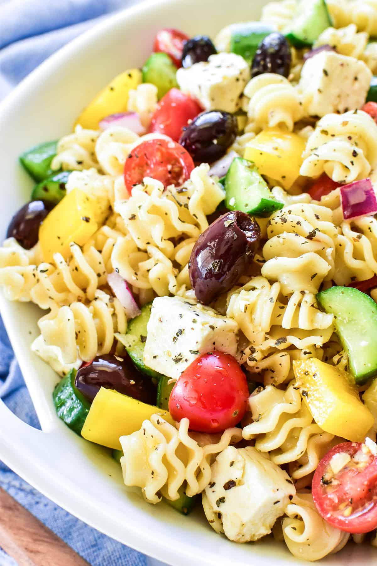 Close up of Greek Pasta Salad in white serving bowl